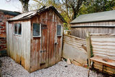 Old run down worn out rotting garden shed — Stock Photo