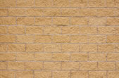 New beige sandstone wall — Stock Photo