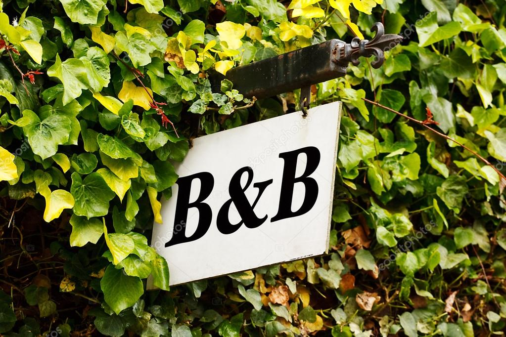 Breakfast Sign Traditional Bed And Breakfast Sign Surrounded by an Ivy Creeper Photo by