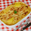 Fish pie on cafe table — Stock Photo