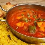 Chicken jalfrezi in balti dish with rice — Stock Photo