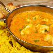 Chicken korma in balti dish with rice — Stock Photo