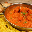 Chicken tikka masala in balti dish with rice — Stock Photo #30896979