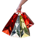 Handful of glossy shopping bags — Stock Photo