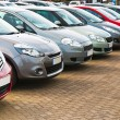 Постер, плакат: Row of different used cars