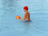 Kid playing water polo — Stock Photo