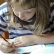 Stock Photo: Girl for homework