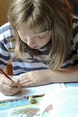 Girl for homework — Stock Photo
