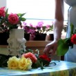 Women putting flowers in vase — Stock Video