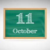 10 月 11 日、黒板にチョークで碑文 — ストックベクタ