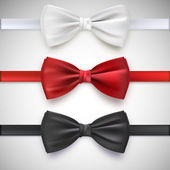 Realistic white, black and red bow tie — Stock Vector
