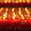 Stock Photo: Burning candles at Buddhist temple