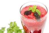 Mix berry smoothie with berries and mint leaf — Stock Photo
