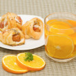 Tea break, orange tea with little  croissant - Stock Photo