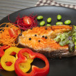 Grilled salmon steak with vegetable salad — Stock Photo