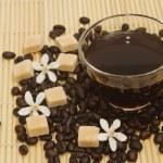 Black coffee and coffee bean — Stock Photo