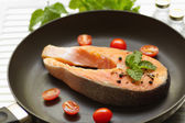 Salmon with pepper,tomato and mint leaf on pan — Stock Photo