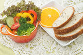 Fresh vegetable salad bowl with whole wheat bread — Stock Photo