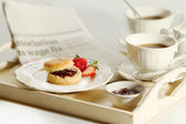 Scone with strawberry jam and clotted cream , afternoon tea brea — Stock Photo