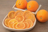 Dehydrated dried and fresh orange in wooden bowl — Stock Photo