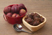 Fresh and dried plums — Stock Photo