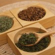 Assortment of dry tea in bowl on wqqden background — Stock Photo