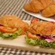 Croissant ham sandwich with fresh vegetable — Stockfoto #29915841