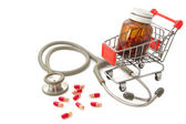 Shopping Cart with capsules and a stethoscope — Stok fotoğraf