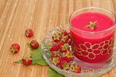Fresh raspberries drink,on wooden background — Stock Photo