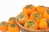 Fresh Persimmon fruit in the basket — Stock Photo