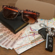 Keys and sunglasses on a road map with pocket money,Ready to tra — Stock Photo
