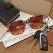 Stock Photo: Keys and sunglasses on road map with pocket money,Ready to tra