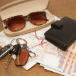 Keys and sunglasses on a road map with pocket money,Ready to tr — Stock Photo