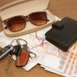 Stock Photo: Keys and sunglasses on road map with pocket money,Ready to tr