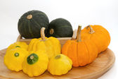 Yellow Patty Pan And Pumpkin on the wooden tray — Stock Photo