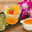Stock Photo: Pudding fruit salad with orange juice, fusion dessert