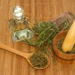 Rosemary product, Rosemary oil bottle and mortar with fresh and — Stock Photo