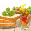 Stock Photo: Bread slice and fruit salad with orange juice, fusion food