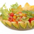 Stock Photo: Fruit salad in melon fruit , fusion food