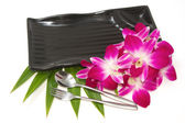 Empty black plate with orchid — Foto de Stock