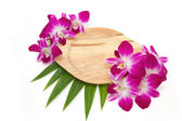 Empty wooden plate with orchid in tableware — Stock Photo