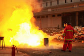 Firefighters in action after a gas explosion — Stock Photo
