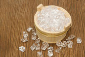 Ice cubes on wooden bucket — Stockfoto