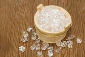 Ice cubes on wooden bucket — Zdjęcie stockowe