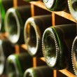 Stacked of old wine bottles in cellar,dusty but tasty — Stock Photo #39258043