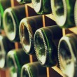 Stacked of old wine bottles in cellar,dusty but tasty — Stock Photo #40818947