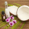 Coconut essentail oil for alternative therapy and beauty spa — Stock Photo #48003389