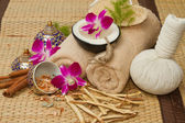 Thai spa massage setting , Massage oil, body scrub, Towels,Cinna — Stock Photo