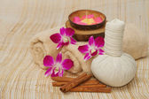 Spa massage setting with herb, towel, compress balls and aroma c — Stock Photo