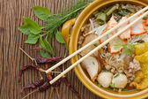 Asian pork noodle in the bowl on wooden background — Stock Photo